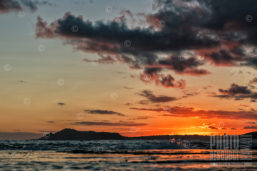 Sunset turns into dusk, with Diamond Head on the left, seen from Maunalua Bay, East O'ahu.