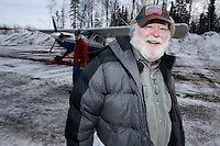 Saturday February 20, 2010.   Volunteer logistics coordinator Mark Kelliher helps keep track of the loads of musher's food bags and supplies as they leave in Iditarod Air force planes from the Willow Airport.