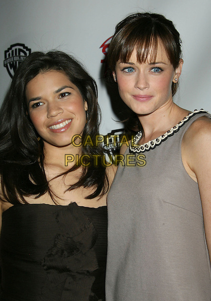 """AMERICA FERRERA & ALEXIS BLEDEL.Warner Bros. """"The Big Picture '08"""" Luncheon during ShoWest, the official convention of the National Association of Theatre Owners, Las Vegas, Nevada, USA, 13 March 2008..half length portrait.CAP/ADM/RE.©Russ Elliot/Admedia/Capital PIctures"""