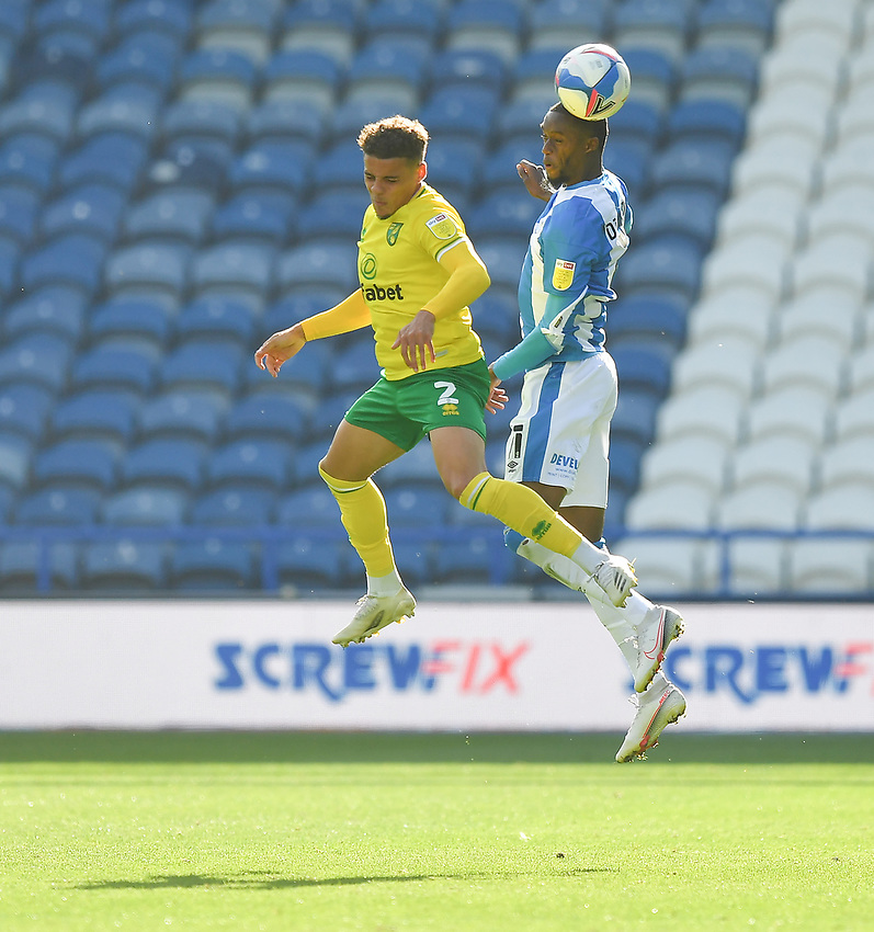 Huddersfield Town's Adama Diakhaby out jumps Norwich City's Max Aarons<br /> <br /> Photographer Dave Howarth/CameraSport<br /> <br /> The EFL Sky Bet Championship - Huddersfield Town v Norwich - Saturday September 12th 2020 - The John Smith's Stadium - Huddersfield<br /> <br /> World Copyright © 2020 CameraSport. All rights reserved. 43 Linden Ave. Countesthorpe. Leicester. England. LE8 5PG - Tel: +44 (0) 116 277 4147 - admin@camerasport.com - www.camerasport.com