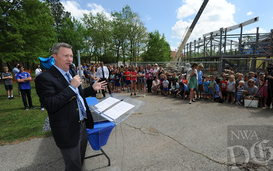NWA Democrat-Gazette/ANDY SHUPE<br /> Dennis Chapman, president and head of school at The New School, speaks Wednesday, April 19, 2017, during a beam raising and tour of the school's expansion project in Fayetteville. The New School hopes to open the facility in the fall for the 2017-18 school year.