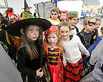 Children from Ennis Holy Family school attending a public performance in the Market before the annual  Clare Champion Halloween Party. Photograph by John Kelly.