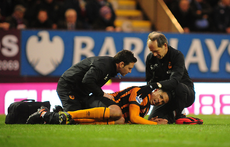 Hull City's Curtis Davies receives treatment for an injury<br /> <br /> Photographer Chris Vaughan/CameraSport<br /> <br /> Football - Barclays Premiership - Burnley v Hull City - Saturday 8th November 2014 - Turf Moor - Burnley<br /> <br /> &copy; CameraSport - 43 Linden Ave. Countesthorpe. Leicester. England. LE8 5PG - Tel: +44 (0) 116 277 4147 - admin@camerasport.com - www.camerasport.com