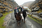 22-2-2011: TRUE GRIT... South Kerry Independent candidate Michael Healy-Rae with his father Jackie canvassing the traditional way on horseback in the Gap of Dunloe, Killarney which is normally restricted to horse traffic. 80 years old Jackie joined Michael to canvas some of the most difficult terrain in the county in a bid to win the last votes on Tuesday. Deputy Healy-Rae is fighting an uphill battle according to the polls to retain his father's seat.<br /> Picture by Don MacMonagle