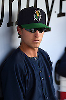Cedar Rapids Kernels shortstop Ryan Walker (26) in the dugout before a game against the Quad Cities River Bandits on August 18, 2014 at Perfect Game Field at Veterans Memorial Stadium in Cedar Rapids, Iowa.  Cedar Rapids defeated Quad Cities 4-2.  (Mike Janes/Four Seam Images)