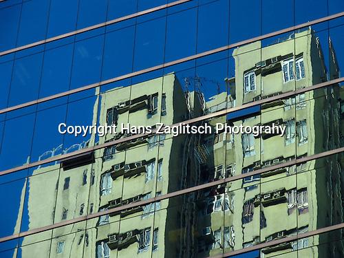 Reflections in a modern glass facade in Hong Kong