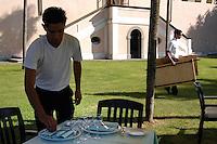 Camerieri preparano i tavoli per il pranzo in giardino..Waiters prepare tables for lunch in the garden...Villa Grazioli è un raffinato albergo della catena internazionale Relais & Chateaux..Fu costruita dal Cardinale Antonio Carafa nel 1580 e racchiude tra le sue mura opere d'arte dei maestri del XVI e XVII secolo, Ciampelli, Carracci e G.P. Pannini. .Villa Grazioli is a sophisticated international hotel chain Relais & Chateaux. .It was built by Cardinal Antonio Carafa in 1580 and contains works of art of the sixteenth and seventeenth century, of Ciampelli, Carracci and GP Pannini....