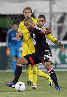 WASHINGTON, DC - AUGUST 4, 2012:  Maicon Santos (29) of DC United keeps the ball away from Carlos Mendes (4) of the Columbus Crew during an MLS match at RFK Stadium in Washington DC on August 4. United won 1-0.