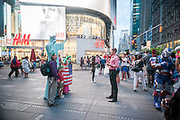 "Costumed characters swarm Times Square in New York on Tuesday, July 29, 2014. The ""actors"" pose for photographs with tourists asking for tips as renumeration. NYPD Commissioner William Bratton has announced his support for a bill in the City Council which would regulate the proliferation of costumed characters begging in Times Square and Sesame Workshop is considering taking legal action to prohibit people from donning unauthorized costumes of their characters such as Elmo.  (© Richard B. Levine)"