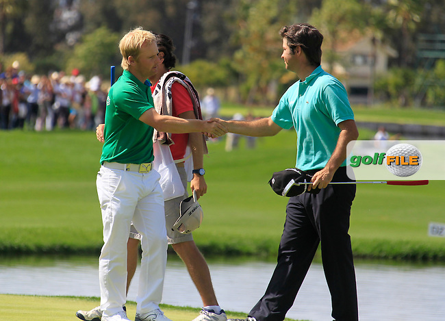 Soren Kjeldsen (DEN) and Jorge Campillo (ESP) finish their match on the 18th green during Sunday's Final Round of the Open de Espana at Real Club de Golf de Sevilla, Seville, Spain, 6th May 2012 (Photo Eoin Clarke/www.golffile.ie)
