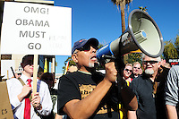 "Phoenix, Arizona. January 19, 2013 - A mans speaks to the crowd expressing his opposition to proposed legislation that would require universal background checks on gun buyers, a federal ban on military-style assault weapons and a limit to the size of ammunition magazines. As President Barack Obama proposed new gun regulations last week, gun owners demonstrated against it with national ""Guns Across America"" rallies to defend the Second Amendment. Dozens showed up at the Arizona State Capitol, many of them carrying weapons. Photo by Eduardo Barraza © 2013"