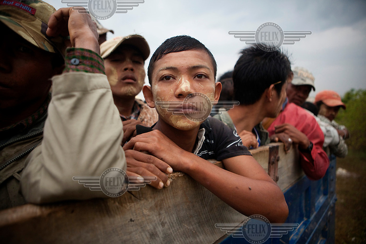 Day labourers cram into the back of a truck as they go to work in the morning in Naypyitaw, the new capital of Burma (Myanmar) since November 2005.
