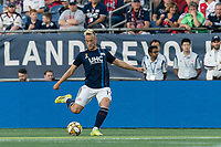 FOXBOROUGH, MA - SEPTEMBER 29: Antonio Mlinar Delamea #19 of New England Revolution passes the ball during a game between New York City FC and New England Revolution at Gillette Stadium on September 29, 2019 in Foxborough, Massachusetts.