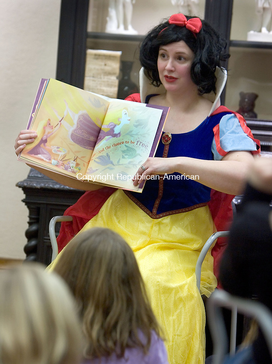 TORRINGTON, CT. 02 February 2013-020213SV03-Snow White, Jennifer Kenney of Torrington, reads to kids during the Take Your Child to the Library Day at the library in Torrington Saturday. The event encouraged parents to bring their child to the library to sign up for a library card. Along with Snow White, there were games, snacks and arts and crafts..Steven Valenti Republican-American