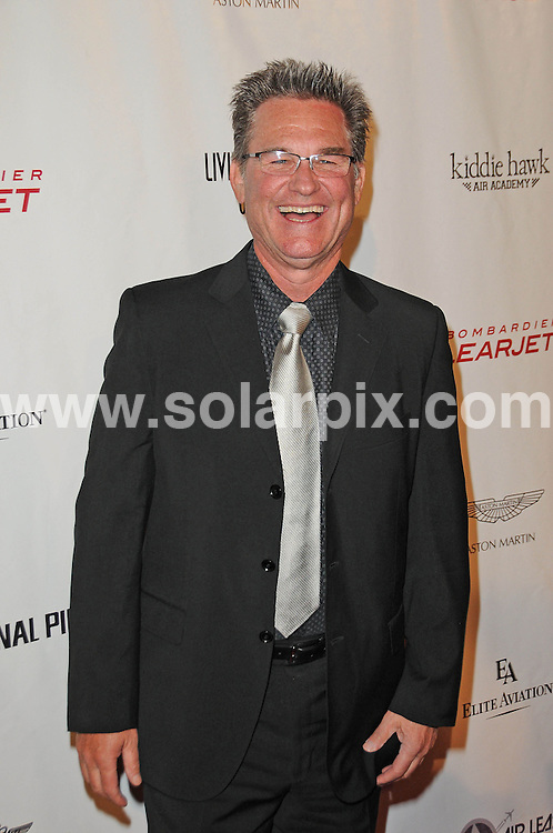 **ALL ROUND PICTURES FROM SOLARPIX.COM**                                             **SYNDICATION RIGHTS FOR UK, AUSTRALIA, DENMARK, PORTUGAL, S. AFRICA, SPAIN & DUBAI (U.A.E) & ASIA (EXCLUDING JAPAN) ONLY**                                                                                  Caption: Arrivals at the 8th Annual Living Legends of Aviation Awards Ceremony. Held at the Beverly Hilton - Beverly Hills, Hollywood, USA. 23 January 2011                                                                              This pic: Kurt Russell                                                        JOB REF: 12699 PHZ Charlotte      DATE: 21_01_2011                                                           **MUST CREDIT SOLARPIX.COM OR DOUBLE FEE WILL BE CHARGED**                                                                      **MUST AGREE FEE BEFORE ONLINE USAGE**                               **CALL US ON: +34 952 811 768 or LOW RATE FROM UK 0844 617 7637**