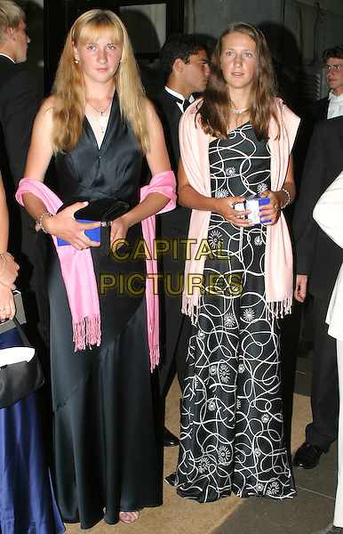 VOLHA HAVARTSOVA & VIKTORIA AZARENKA.Leaving the Wimbledon Champions dinner at the Savoy Hotel, London,.4th July 2004..full length .www.capitalpictures.com.sales@capitalpictures.com.©Capital Pictures