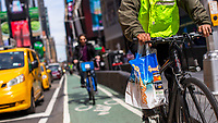 NEW YORK, NY - APRIL 2: A delivery carries plastic bags on his bike on April 2, 2019 in New York. New York will become the second state in U.S. to ban shops from providing single-use plastic bags for most purchases.  (Photo by Eduardo MunozAlvarez/VIEWpress)