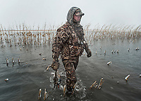 Pat Berggren (cq) carries a duck back after a kill during a hunting trip just off the duck-rich Platte River in Nebraska, Saturday, December 3, 2011...Photo by Matt Nager