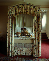 This child's bedroom is furnished with a grown up four-poster bed draped in antique chintz