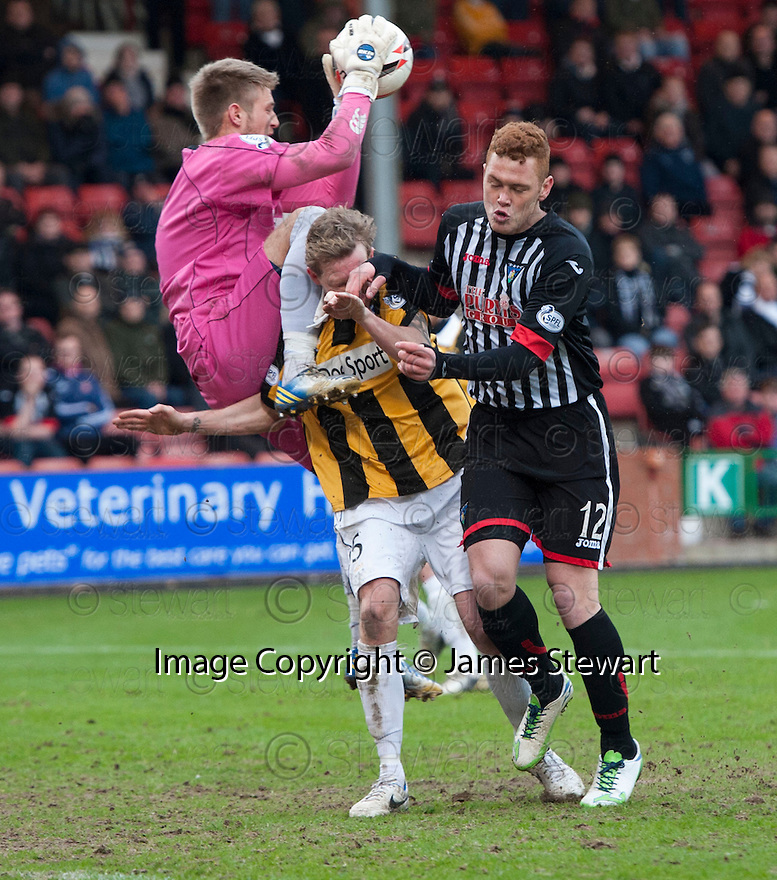 East Fife's Steven Campbell gets clobbered as East Fife keeper Greg Paterson collects the ball ahead of Pars' Ryan Thomson.