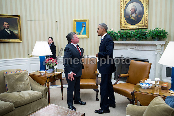 United States President Barack Obama and King of Jordan Abdullah II bin Al-Hussein talk after delivering remarks to the news media in the Oval Office of the White House in Washington, DC, USA, 24 February 2016. The two leaders focused their talks on ending the conflict in Syria and finding a solution for the refugee crisis. Photo Credit: Shawn Thew/CNP/AdMedia