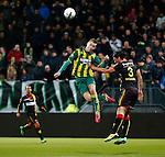 Nederland, Den Haag, 21 februari 2014<br /> Eredivisie<br /> Seizoen 2013-2014<br /> ADO Den Haag-Go Ahead Eagles <br /> Mike van Duinen van ADO Den Haag en Bart Vriends (r.) van Go Ahead Eagles strijden in een kopduel om de bal.