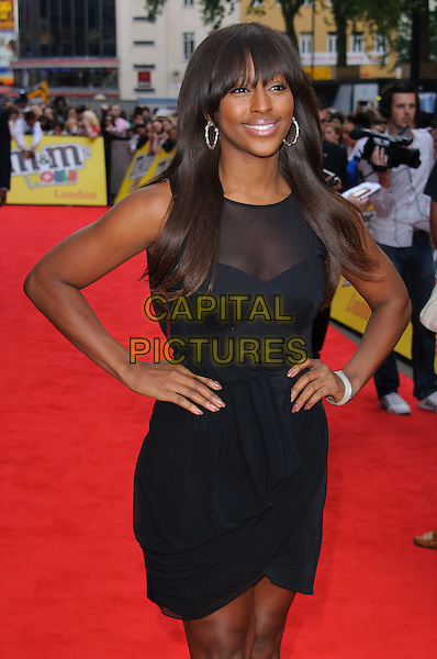 Alexandra Burke.Official opening of the M&M's World London store, Leicester Square, London, England..July 6th, 2011.half length dress hands on hips black sheer fringe bangs sleeveless .CAP/CJ.©Chris Joseph/Capital Pictures.