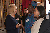 London, Uk. 15/10/2015. HRH The Duchess of Cornwall is introduced to the mother of Senior Runner-up Tawanda Mulalu from Botswana. The Duchess of Cornwall on behalf of Her Majesty The Queen, Patron of The Royal Commonwealth Society, holds a reception for winners of The Queen's Commonwealth Essay Competition at Buckingham Palace. The Queen's Commonwealth Essay Competition was founded in 1883 and is the world's oldest international schools' writing contest. This year's competition, sponsored by Cambridge University Press, received more than 13,000 entries from over 600 schools in 49 Commonwealth countries and territories. The Duchess of Cornwall hands out awards to young writers who have travelled from across the Commonwealth to attend the reception. This year's winners have come from Cyprus, Botswana, The Cayman Islands and as far away as Tristan da Cunha - over 9000km away.