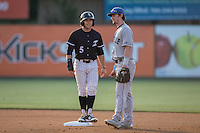 Tyler Sullivan (5) of the Kannapolis Intimidators chats with Asheville Tourists second baseman Brendan Rodgers (1) at Kannapolis Intimidators Stadium on May 27, 2016 in Kannapolis, North Carolina.  The Tourists defeated the Intimidators 7-6.  (Brian Westerholt/Four Seam Images)