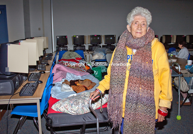 SEYMOUR CT.-26 OCTOBER 2011 110211DA07- Florence Fadden, 88, of Seymour takes refuge at a shelter inside Seymour Middle School on Wednesday.  The shelter provides heat, food, beverages, showers and a charging stations for cell phones and electronic devices.<br /> Darlene Douty Republican American.