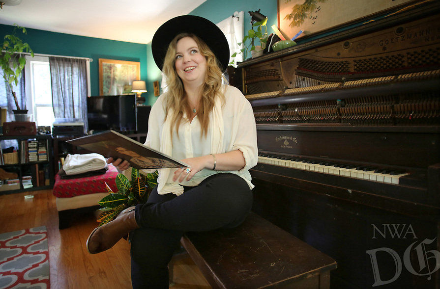NWA Democrat-Gazette/DAVID GOTTSCHALK Meredith Kimbrough sits Monday, July 16, 2018, at the paino in the living room area of her home that doubles as the state-of-the-art Homestead Recording audio recording studio in Fayetteville. The house was once lived in by Kimbrough's great great grandmother.