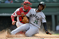 Catcher Samuel Miranda (21) of the Greenville Drive makes the putout on Manuel Geraldo (26) of the Augusta GreenJackets in the third inning of a game on Thursday, May 17, 2018, at Fluor Field at the West End in Greenville, South Carolina. Augusta won, 2-1. (Tom Priddy/Four Seam Images)