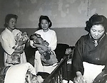 December 5, 1947 : Tokyo, Japan - Nurses held children at The University of Tokyo Hospital in December 5, 1947, Tokyo, Japan. The first Baby boom in Japan is 1947 - 1949 which just after end of World War 2. This generation called 'Dankainosedai'. (Photo by Kingendai Photo Library/AFLO)