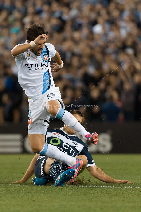 MELBOURNE 25 Oct 2014 – Spanish player David VILLA of Melbourne City is tackled by Adrian LEIJER of the Victory in the round 3 match between Melbourne Victory and Melbourne City in the Australian Hyundai A-League 2014-15 season at Etihad Stadium, Melbourne, Australia.