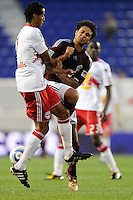 Roy Miller (7) of the New York Red Bulls collides with Quincy Amarikwa (12) of the Colorado Rapids while going for a ball. The New York Red Bulls defeated the Colorado Rapids 3-0 during a U. S. Open qualifier match at Red Bull Arena in Harrison, NJ, on May 26, 2010.