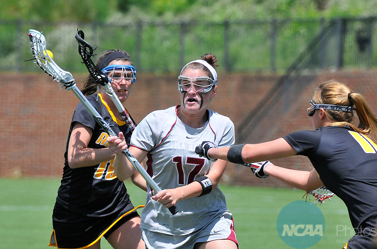 18 MAY 2014: Loch Haven's Kelly Hamilton (17)  is trapped by Adelphi University players at the Division II Women's Lacrosse Championship held at Kerr Stadium in Salem, VA.  Adelphi defeated Lock Haven 7-5 to win the national title.  Andres Alonso/NCAA Photos