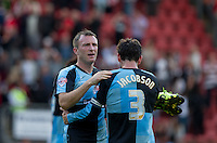 Garry Thompson of Wycombe Wanderers with Joe Jacobson of Wycombe Wanderers on the final whistle during the Sky Bet League 2 match between Leyton Orient and Wycombe Wanderers at the Matchroom Stadium, London, England on 19 September 2015. Photo by Andy Rowland.