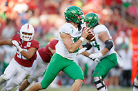 STANFORD, CA - SEPTEMBER 21: Justin Herbert #10 of the Oregon Ducks looks for a pass receiver during a game between University of Oregon and Stanford Football at Stanford Stadium on September 21, 2019 in Stanford, California.
