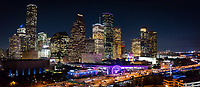 Aerial Houston Skyline Pano2 -  An aerial view of the Houston Skyline after dark taken using our S900 drone.  This angle show the Houston Aquarium with the purple ferris wheel and the colorful city hall in a rainbow of colors as the high rise buildings light up along IH45 in downtown.  You can also see all the many skycrapers near the Theater District in the city .  Houston is know for having many cultural events and this area has museums,, art, theater, plays , opera, and many music event along with the Aquarium. Houston is the most populous city in Texas and fourth most populous in the US currently the population is 3.4 million as of the 2016 census.