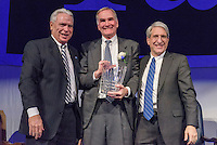 Yale President Peter Salovey and Athletics Director Thomas A. Beckett presenting David Swensen '76. Yale Athletics Blue Leadership Ball & George H.W. Bush '48 Lifetime of Leadership Awards. 20 November 2015 at the William K. Lanman Center, Payne Whitney Gymnasium, Yale University.