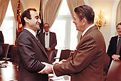 United States President Ronald Reagan meets with Elie Adib Salem, Deputy Prime Minister and Minister of Foreign Affairs of Lebanon in the Cabinet Room of the White House in Washington, DC on December 15, 1982.<br /> Mandatory Credit: Mary Anne Fackelman / White House via CNP