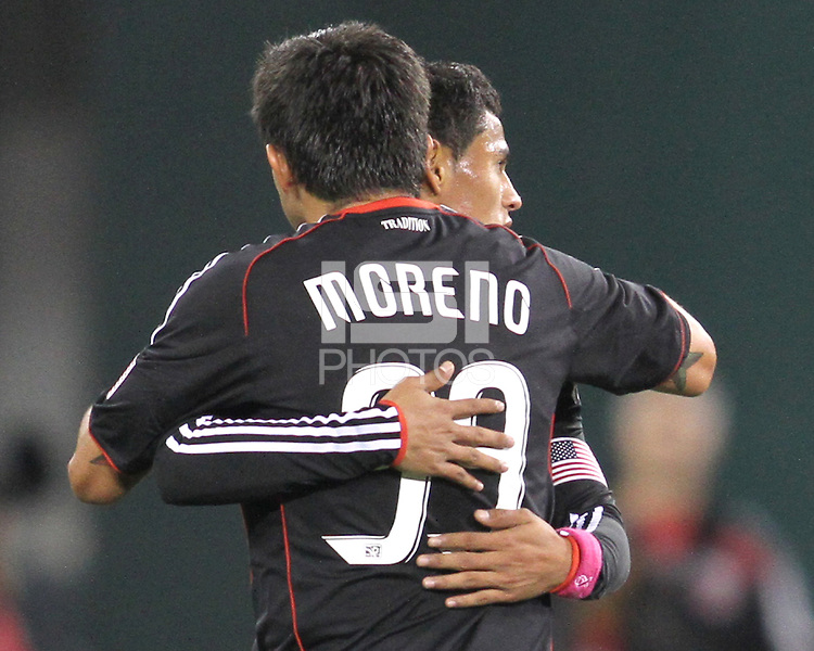 The old and the new Jaime Moreno #99 of D.C. United embraces Andy Najar #14 during an MLS match against Toronto FC that was the final appearance of D.C. United's Jaime Moreno at RFK Stadium, in Washington D.C. on October 23, 2010. Toronto won 3-2.