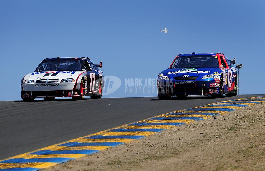 Jun. 21, 2009; Sonoma, CA, USA; NASCAR Sprint Cup Series driver Sam Hornish Jr (77) races alongside Max Papis (13) during the SaveMart 350 at Infineon Raceway. Mandatory Credit: Mark J. Rebilas-