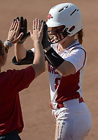 NWA Democrat-Gazette/ANDY SHUPE<br /> Arkansas third baseman Autumn Buczek celebrates Friday, May 18, 2018, after an RBI single during the third inning against DePaul at Bogle Park during the NCAA Fayetteville Softball Regional on the university campus in Fayetteville. Visit nwadg.com/photos to see more photographs from the game.