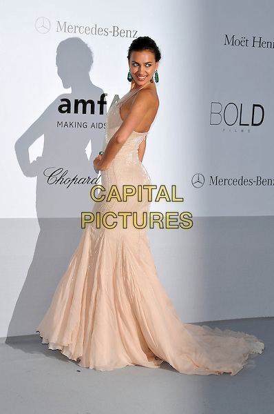 Irina Shayk (Irina Shaykhlislamova).AmFAR Cinema Against AIDS 2012, Hotel du Cap, Antibes during the 65th  Cannes Film Festival, France..24th May 2012.full length pink cream peach dress side looking over shoulder hand on hip.CAP/PL.©Phil Loftus/Capital Pictures.
