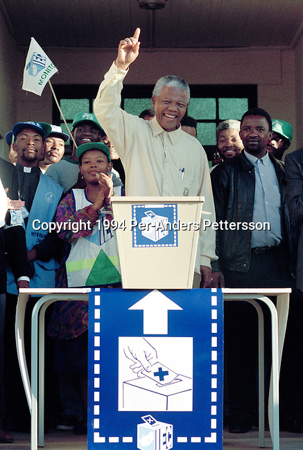 DURBAN, SOUTH AFRICA - APRIL 27: Nelson Mandela casts his historic vote in a small voting station on April 27, 1994 at Oshlange High School outside Durban, South Africa. The historic democratic election was held on April 27, 1994 and Mr. Mandela and his party, the African National Congress, won. Mr. Mandela became the first black democratic elected president in South Africa. He retired from office after one term in June 1999. (Photo by Per-Anders Pettersson).