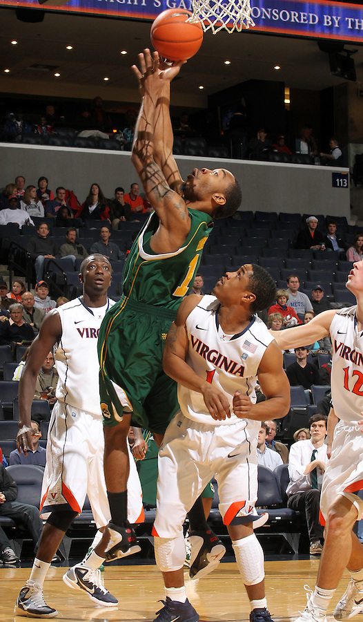 Dec. 20, 2010; Charlottesville, VA, USA; Norfolk State Spartans guard/forward Rob Hampton (1) shoots the ball in front of Virginia Cavaliers center Assane Sene (5), Virginia Cavaliers guard Jontel Evans (1) and Virginia Cavaliers guard Joe Harris (12) during the game at the John Paul Jones Arena. Mandatory Credit: Andrew Shurtleff