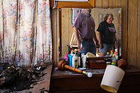 Todd Peters and Janell Fields looks around the remains of her mother's house Wednesday, Aug. 30, 2017, after Hurricane Harvey swept through Lamar.