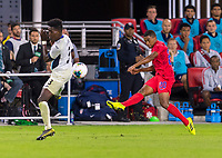 WASHINGTON, DC - OCTOBER 11: Erick Rizo #3 of Cuba tries block the cross of Reggie Cannon #20 of the United States during a game between Cuba and USMNT at Audi Field on October 11, 2019 in Washington, DC.