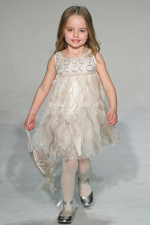 Model walks runway in an outfit from the Biscotti and Kate Mack Fall 2015 collection, by Many Biscotti and Kate Mack, during petitePARADE Fall 2015.
